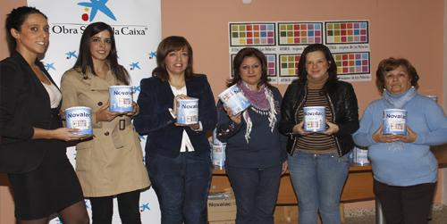 Las familias más necesitadas del municipio sevillano de Los Palacios y Villafranca reciben leche de iniciación
